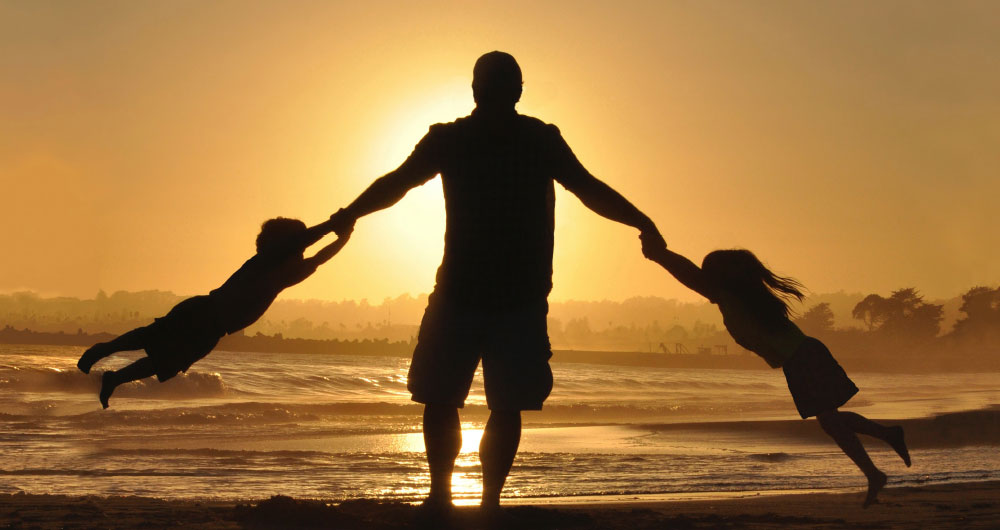 father-swinging-kids-at-sunset