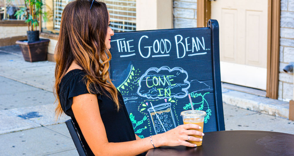 woman-drinking-coffe-at-the-good-bean-cafe